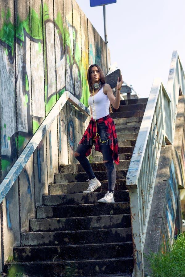Teen girl with skateboard. Outdoors, urban lifestyle. Cute teen girl with skateboard. Outdoors, urban lifestyle royalty free stock photo