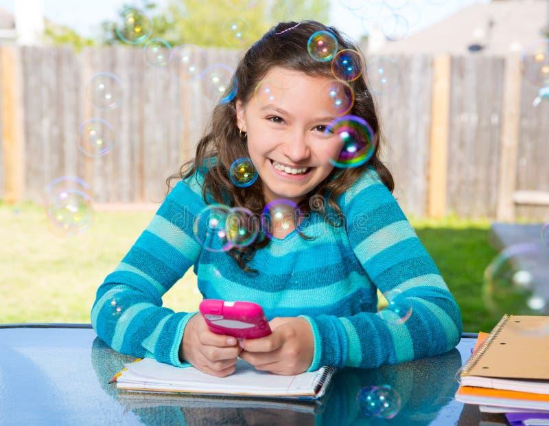 Download Teen Girl With Smartphone Doing Homework Stock Photo - Image: 31376366