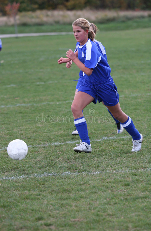 Download Teen Girl Soccer Player Chasing Ball Stock Image - Image: 4882345