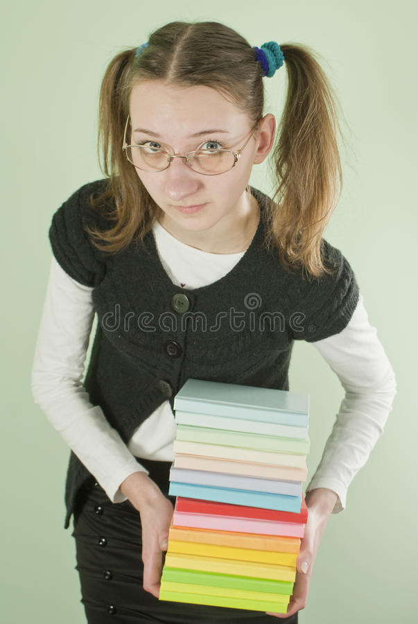 Download Teen Girl With A Stack Of Books Stock Photo - Image: 19187476