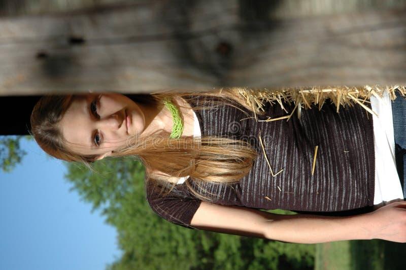 Teen Girl standing in barn stock photos
