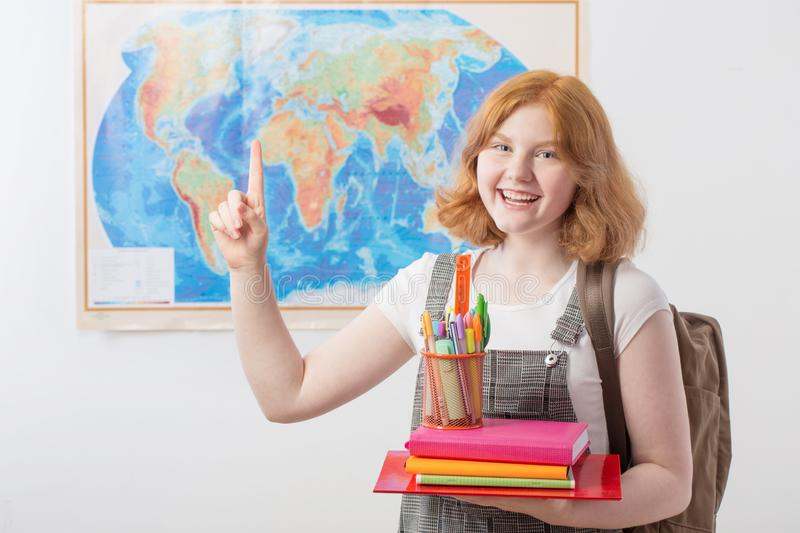 Teen girl stands at  geographical map royalty free stock image