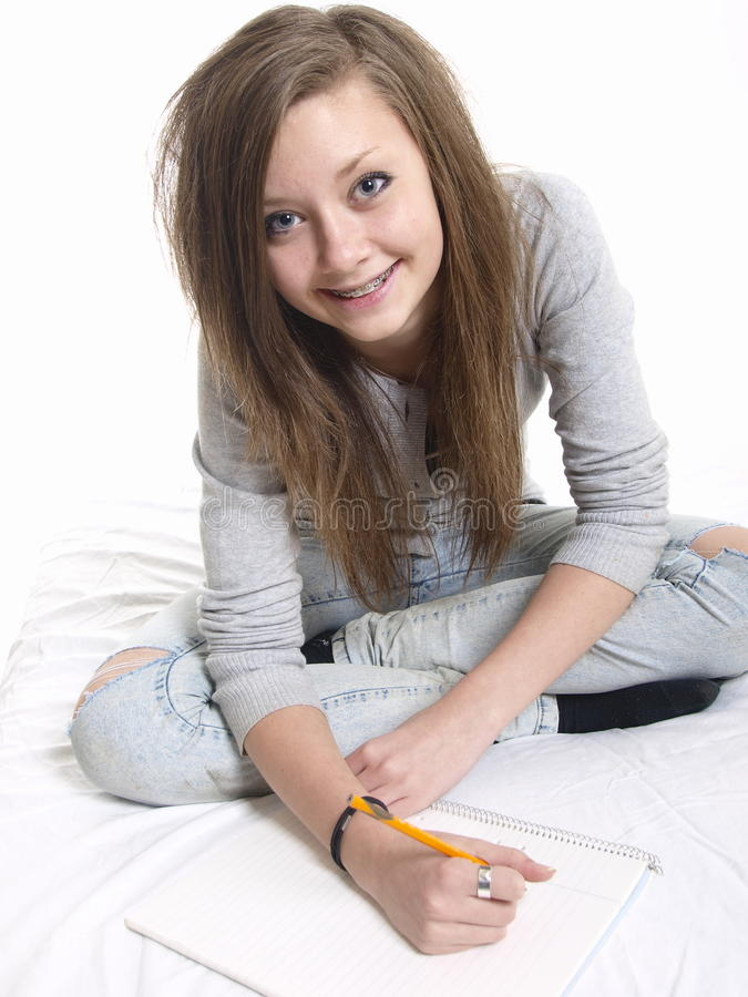 Download Teen girl studying stock image. Image of sits, writer - 11726069