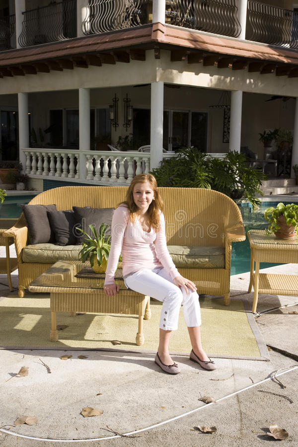 Download Teen girl on sunny patio stock photo. Image of relaxed - 10641978