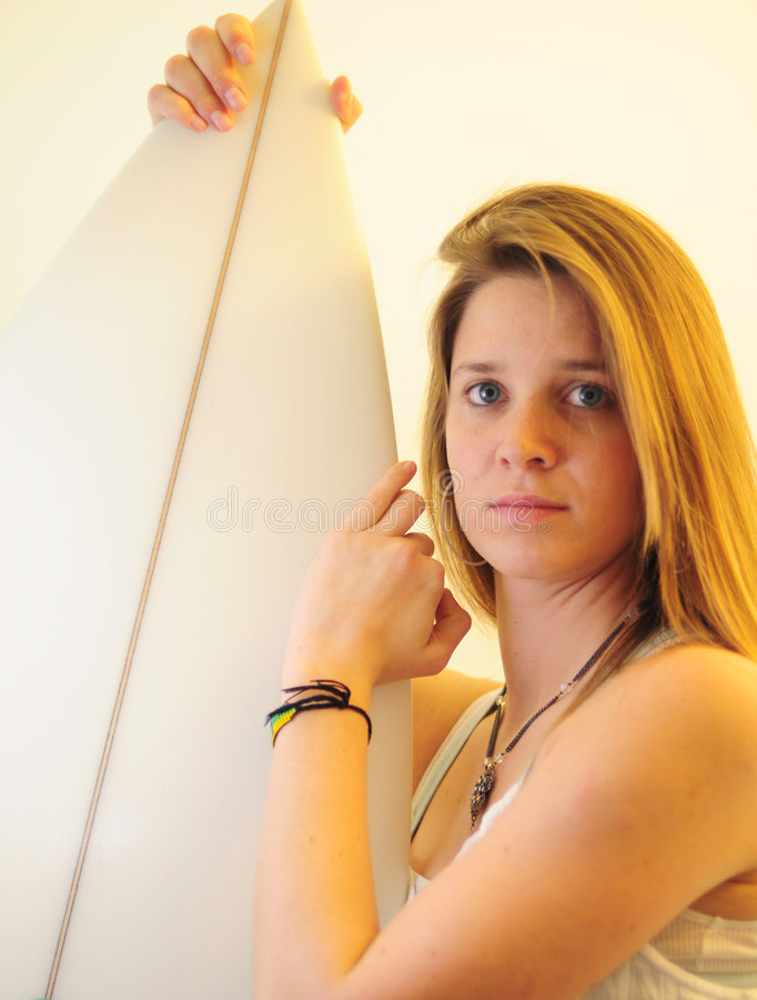 Teen girl with surfboard stock images