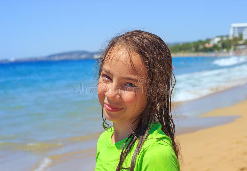 Teen girl surfing on tropical beach. Child on surf board on ocean wave. Active water sports for Teenager. Cute Teen girl surfing on tropical beach. Child on surf royalty free stock image
