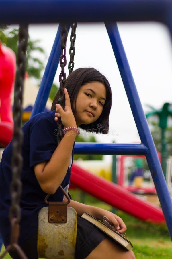 Teen girl swings Playground. royalty free stock photo