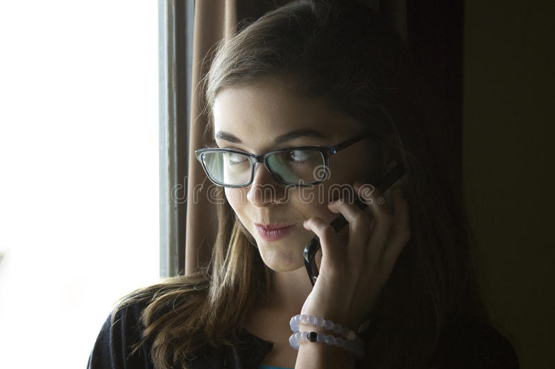 Teen girl talking on the phone royalty free stock image