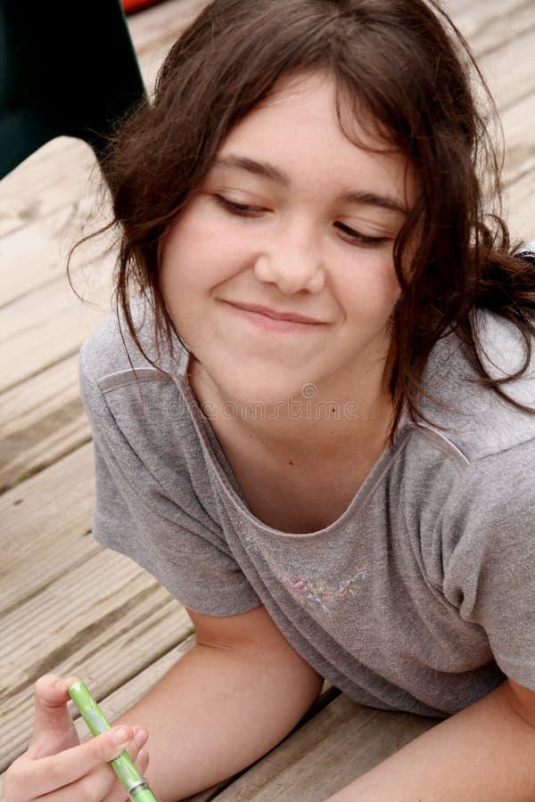 Teen girl thinking royalty free stock image