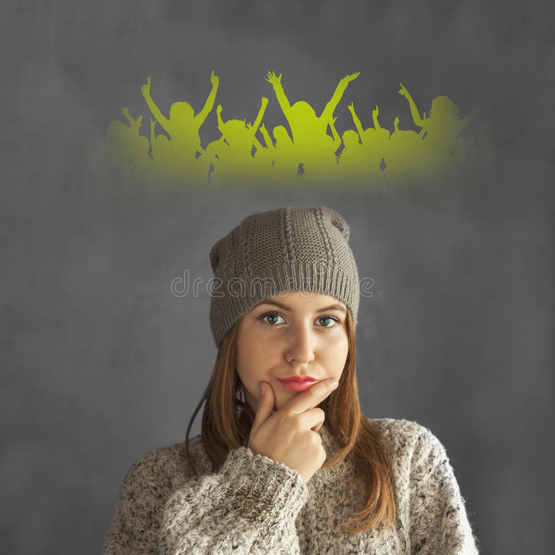 Teen girl thinking of a party. Teen girl dressed casual thinking to her party royalty free stock image