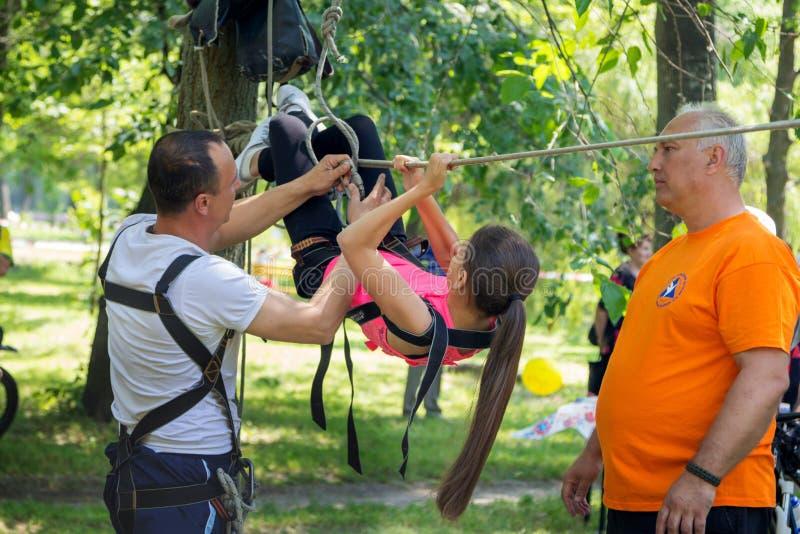 Teen girl training on tyrolean traverse royalty free stock photos