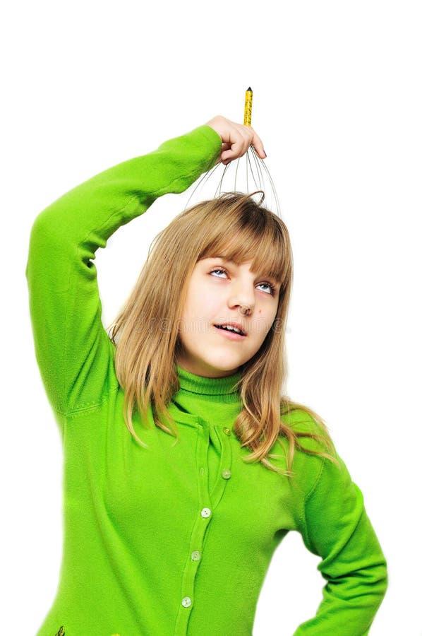 Teen girl using head scalp massage stock photos