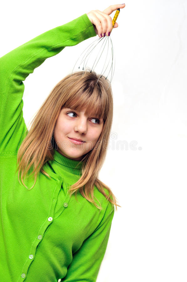 Teen girl using head scalp massage stock photography