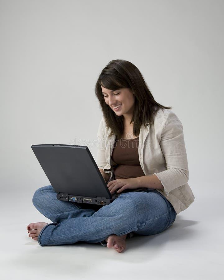 Download Teen girl using laptop stock image. Image of feet, lady - 2601551