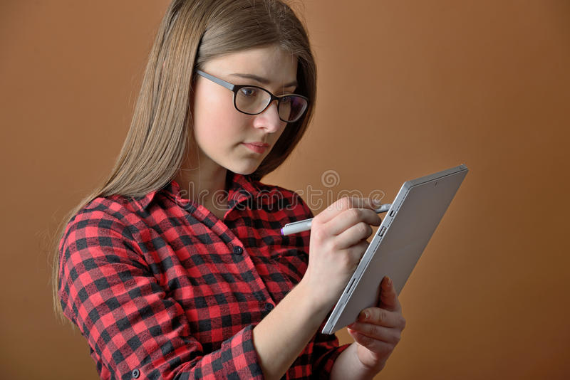 Teen girl using tablet computer royalty free stock photo