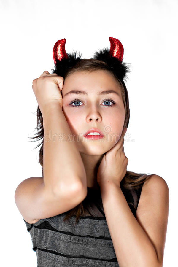 Download Teen Girl Wearing Devil Horns Stock Photo - Image of evil, young: 28978896