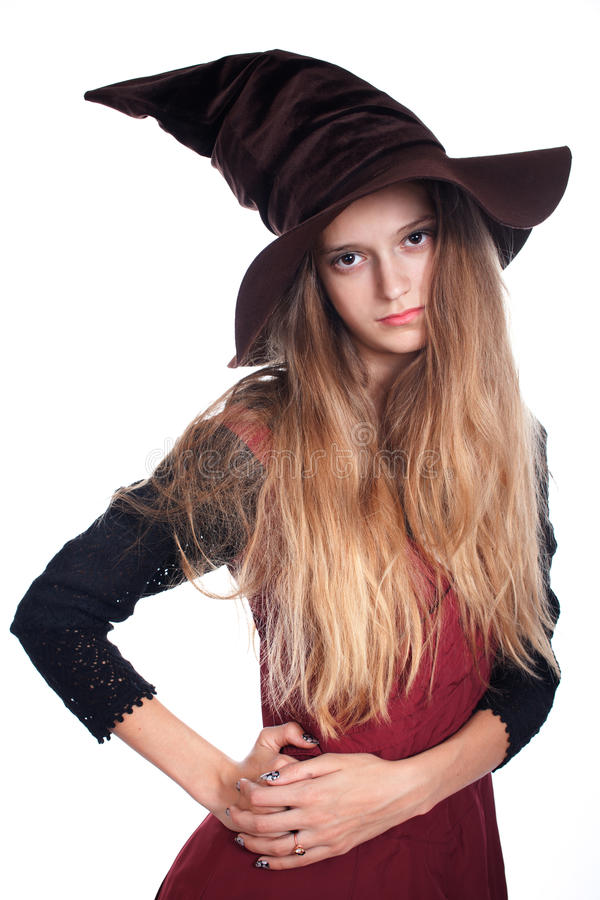 Teen girl wearing halloween witch costume royalty free stock photography