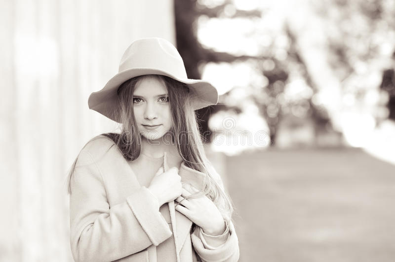 Teen girl wearing winter clothes stock photo