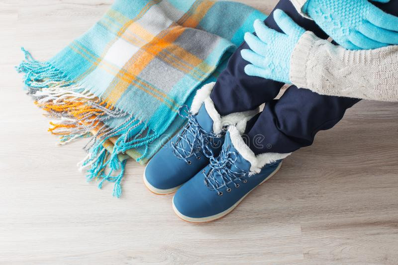 Girl in winter shoes on floor. Teen girl in winter shoes on floor royalty free stock photography