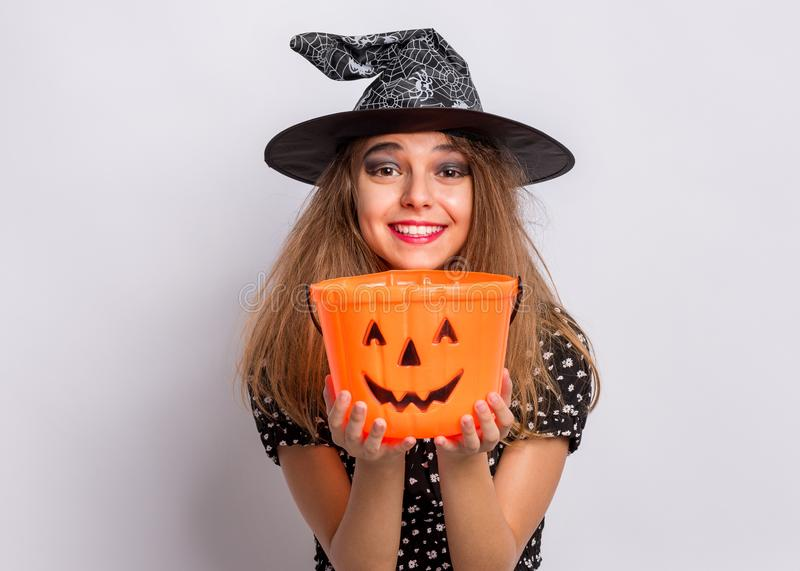 Teen girl in witch black hat royalty free stock photos