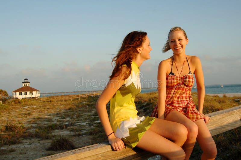 Teen girls at beach stock photos