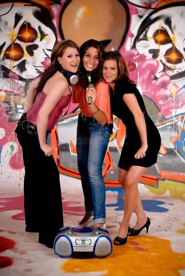 Teen girls graffiti wall royalty free stock photos