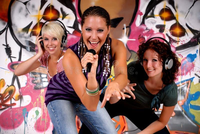 Teen girls graffiti wall royalty free stock photography