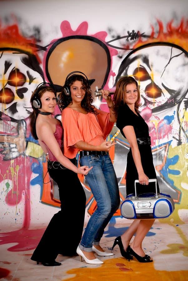 Teen girls graffiti wall royalty free stock photo