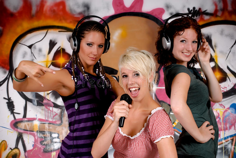 Teen girls graffiti wall stock photo