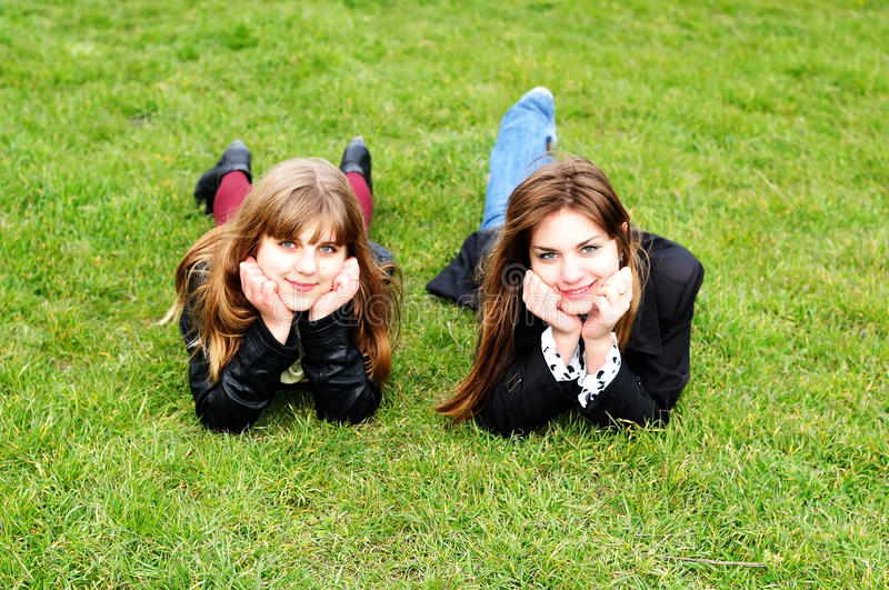 Download Teen Girls Laying On The Green Grass Stock Photo - Image: 13604978