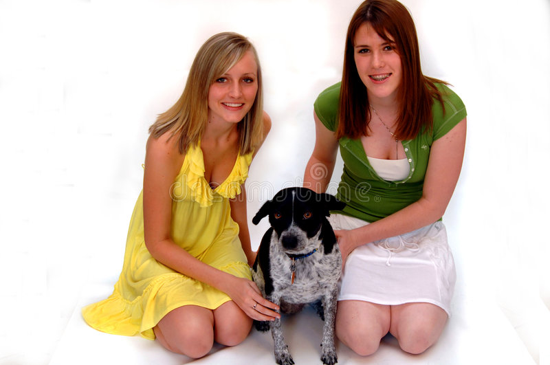Teen girls with pet dog stock image