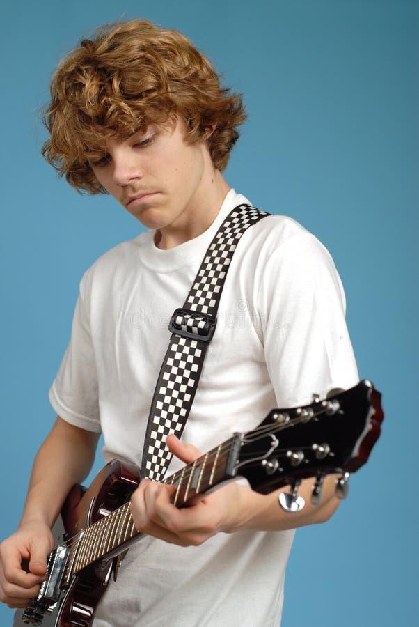 Teen guitar player stock image