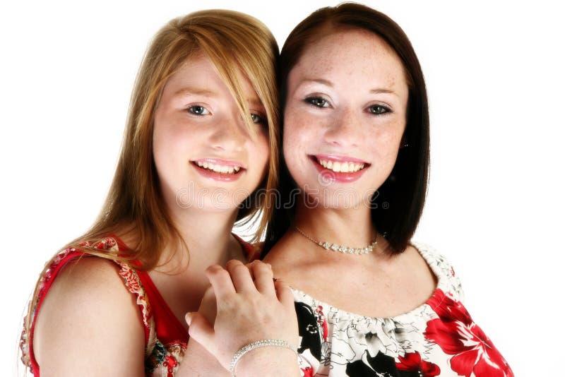 teen härliga systrar arkivfoto