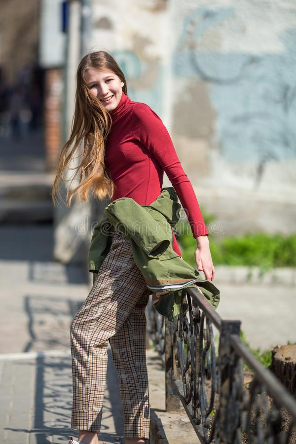 Teen happy girl walking on the streets stock photography