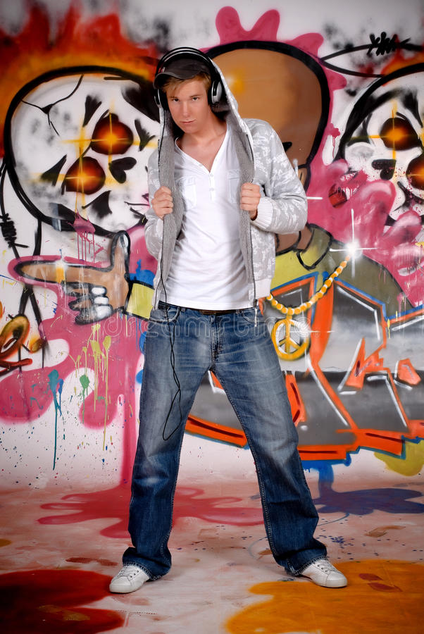 Teen headset graffiti wall royalty free stock image