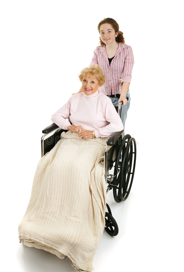 Teen Helps Disabled Senior royalty free stock image