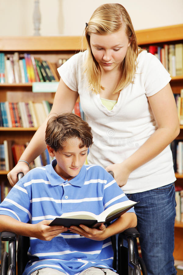 Teen Helps Younger Student stock photos