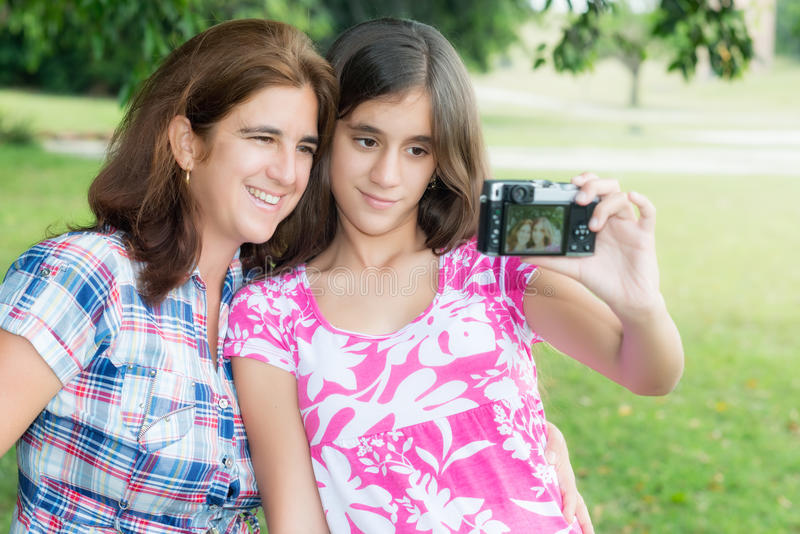 Teen and her young mother taking a self picture royalty free stock photos