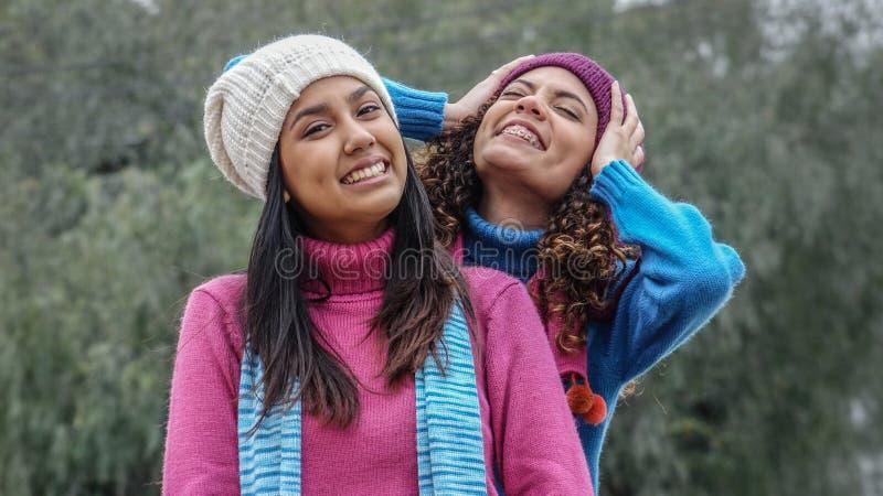 Teen Hispanic Girls Having Fun During Winter royalty free stock images