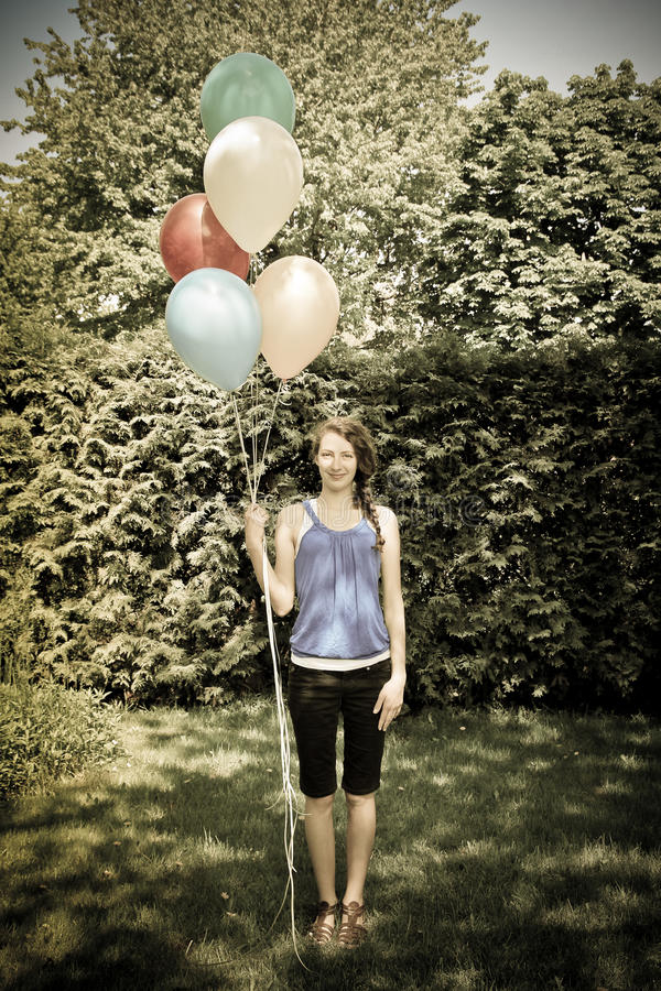 Teen holding balloons stock image