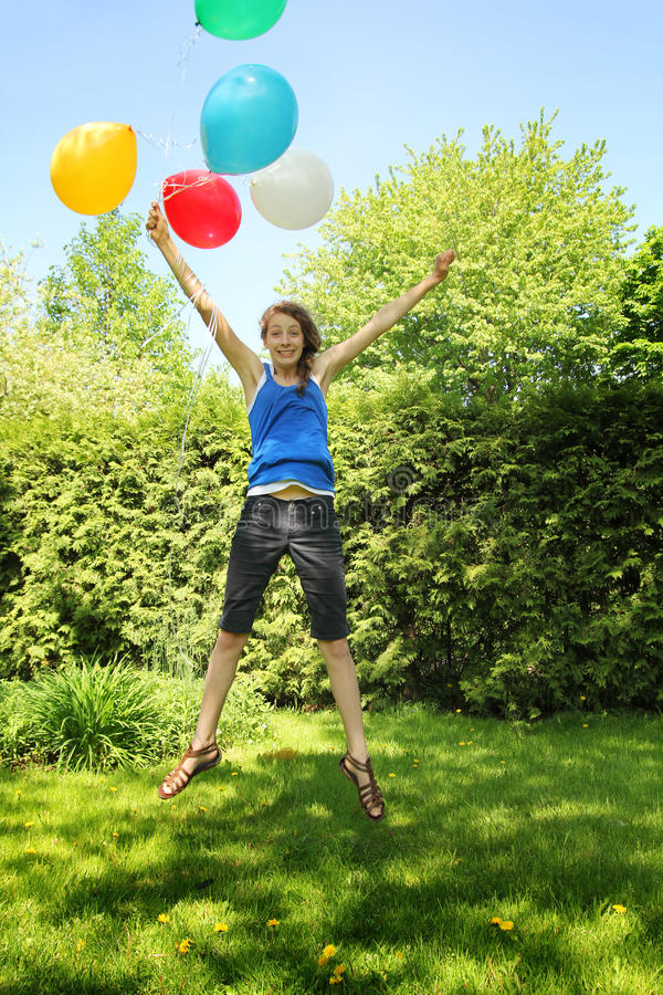 Teen holding baloons stock photography