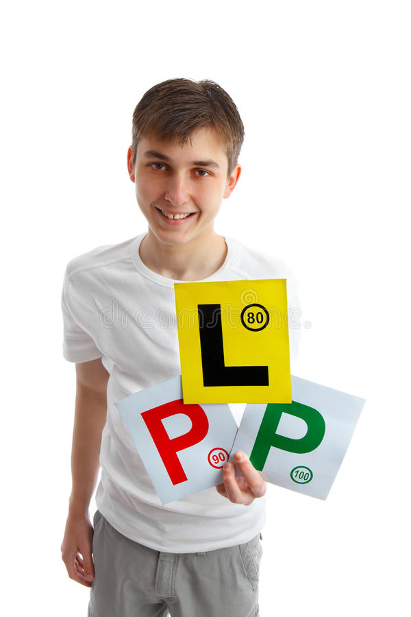 Teen holding driving licence plates for car. A teenage boy holding three magnetic licence plate signs for displaying on car stock photography