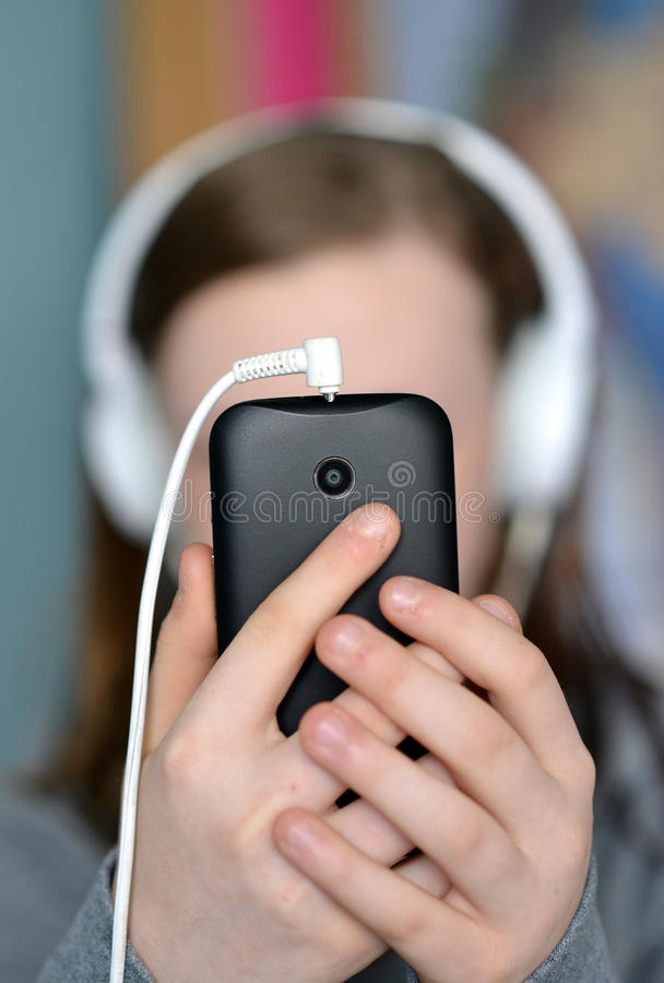 Teen holding mobile PHONE royalty free stock photo