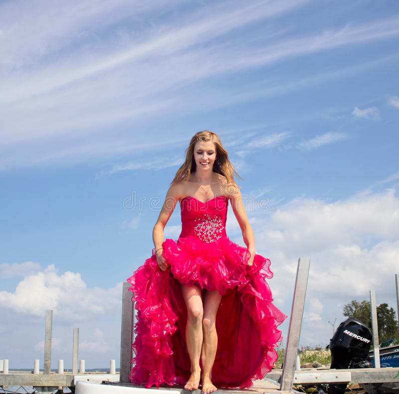 Free Teen Holding Up Prom Dress Royalty Free Stock Photography - 43850297