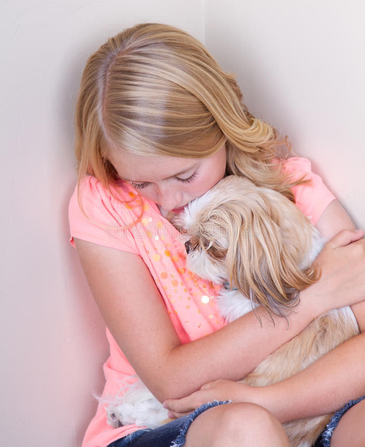 Download Teen hugging dog in corner stock photo. Image of fear - 32298524