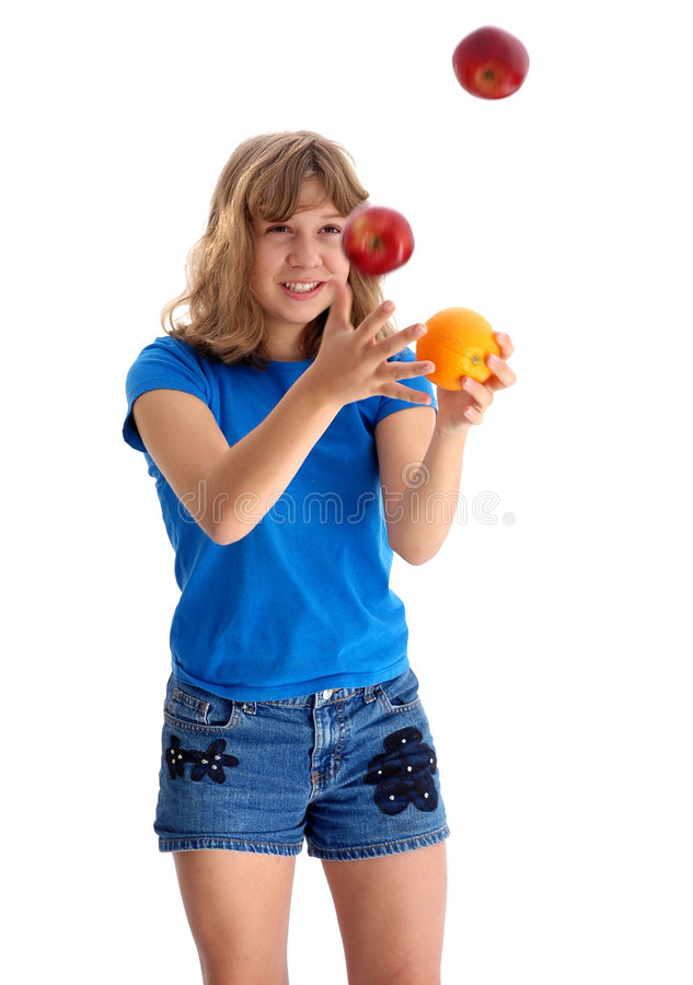 Free Teen Juggling Apple And Orange 2 Royalty Free Stock Photo - 214315
