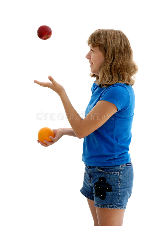Teen Juggling Apple and Orange stock images