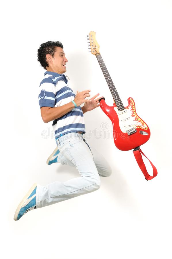 Teen jumping with guitar royalty free stock photo