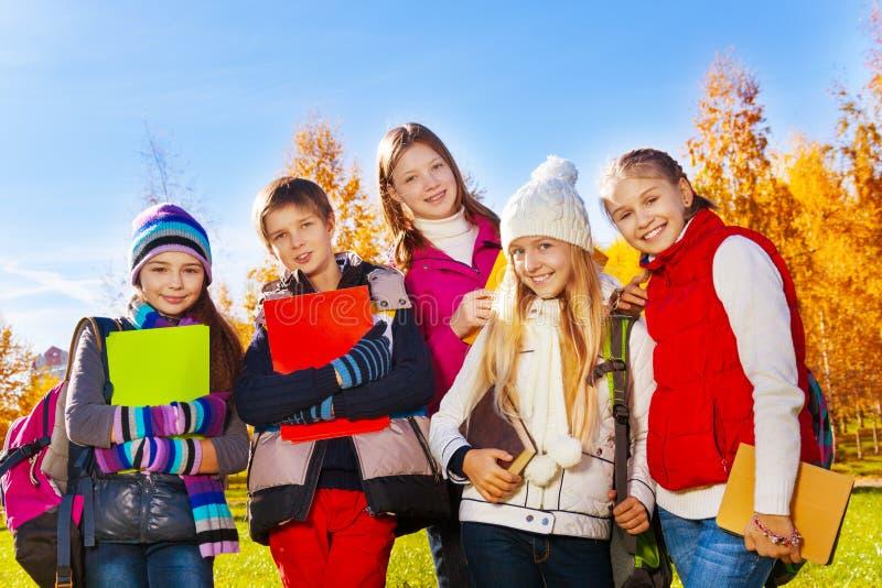 Teen kids after school stock photos