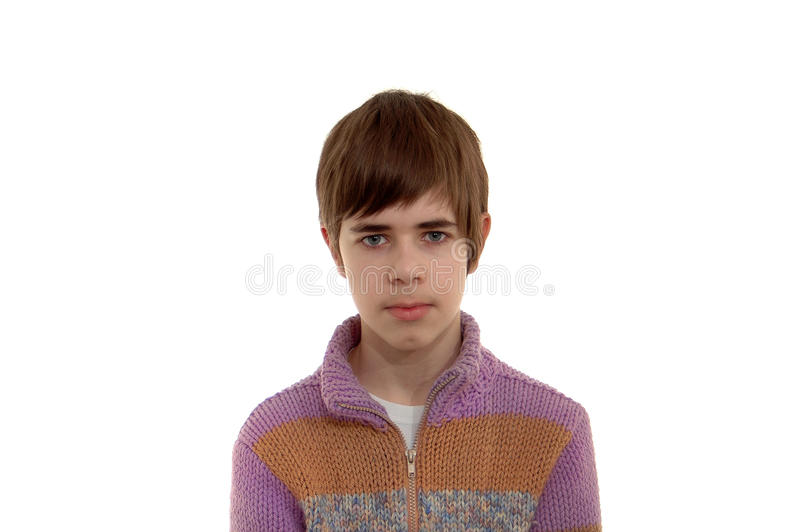 Teen in a knitted jumper isolated on white. Half-length portrait of a teen isolated on white background royalty free stock images